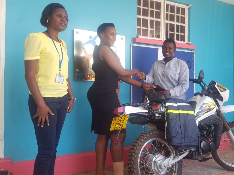 COHRE DIRECTOR RECEIVES A BIKE FROM IDI
